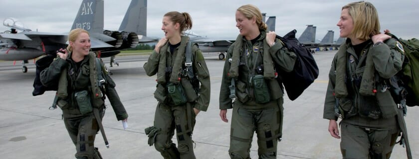 "ELMENDORF AFB, Alaska -- Four F-15C pilots from the 3rd Wing step to their respective jets July 5 for the fini flight of Maj. Andrea ""Gunna"" Misener, 19th Figher Squadron, pictured far left.  To her right are Capt. Jammie ""Trix"" Jamieson of the 12th Fighter Squadron, Maj. Carey ""Mamba"" Jones, 19th Fighter Squadron, and Capt. Samantha ""Combo"" Weeks, 12th Fighter Squadron.  When Maj. Misener worked out who would be joining her in her four-ship fini flight, it became apparent there was a probable first in the Eagle community.  Despite the growing number of females who have joined the ranks of fighter pilots since the career opened up to women in 1993, an all-female four-ship had not been accomplished in the F-15C before.   ""It was a great flight,"" said Maj. Misener after her final flight at Elmendorf.  ""We killed all the bandits and protected the target area.  There were no Eagle losses.""  The major says she will miss her flying squadron, as she moves on to new challenges at the year-long Joint Military Intelligence College in Washington D.C. (photo by Tech. Sgt. Keith Brown)"