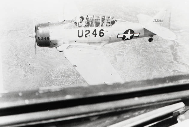 This image, taken from an AT-6 in flight shows the colored cowling and U fuselage code during the later portion of the WASP training program. (Image courtesy of The WASP Archive, The TWU Libraries' Woman's Collection, Texas Woman's University, Denton, Texas